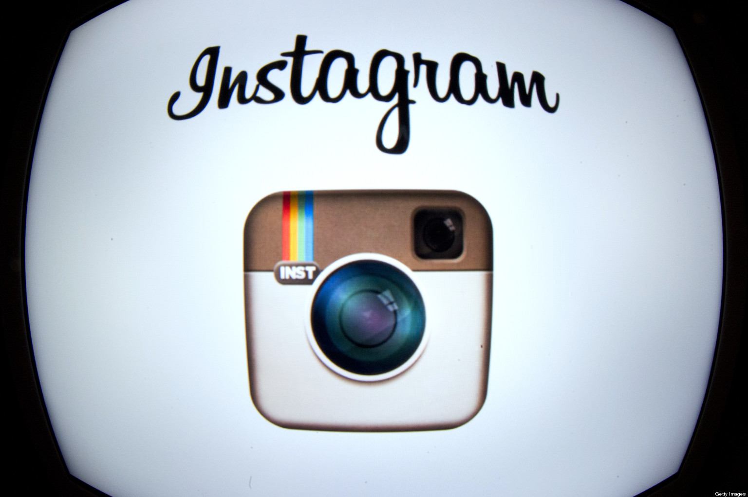 The Instagram logo is displayed on a tablet on December 20, 2012 in Paris. Instagram backed down on December 18, 2012 from a planned policy change that appeared to clear the way for the mobile photo sharing service to sell pictures without compensation, after users cried foul. Changes to the Instagram privacy policy and terms of service set to take effect January 16 had included wording that appeared to allow people's pictures to be used by advertisers at Instagram or Facebook worldwide, royalty-free. AFP PHOTO / LIONEL BONAVENTURE (Photo credit should read LIONEL BONAVENTURE/AFP/Getty Images)