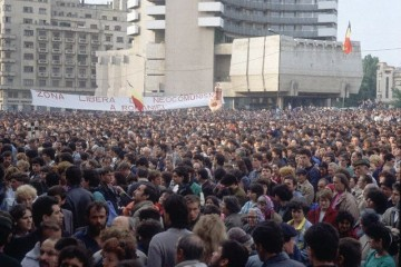 Anti-Communist protesters gather in University Square in Bucharest before the Romanian national elections in May 1990. Communist dictator Nicolae Ceaucescu was overthrown and executed in December 1989, and protesters demand that his successor Iliescu and other Communist Party officials should not be allowed to compete in the free elections. May 2, 1990 Bucharest, Romania